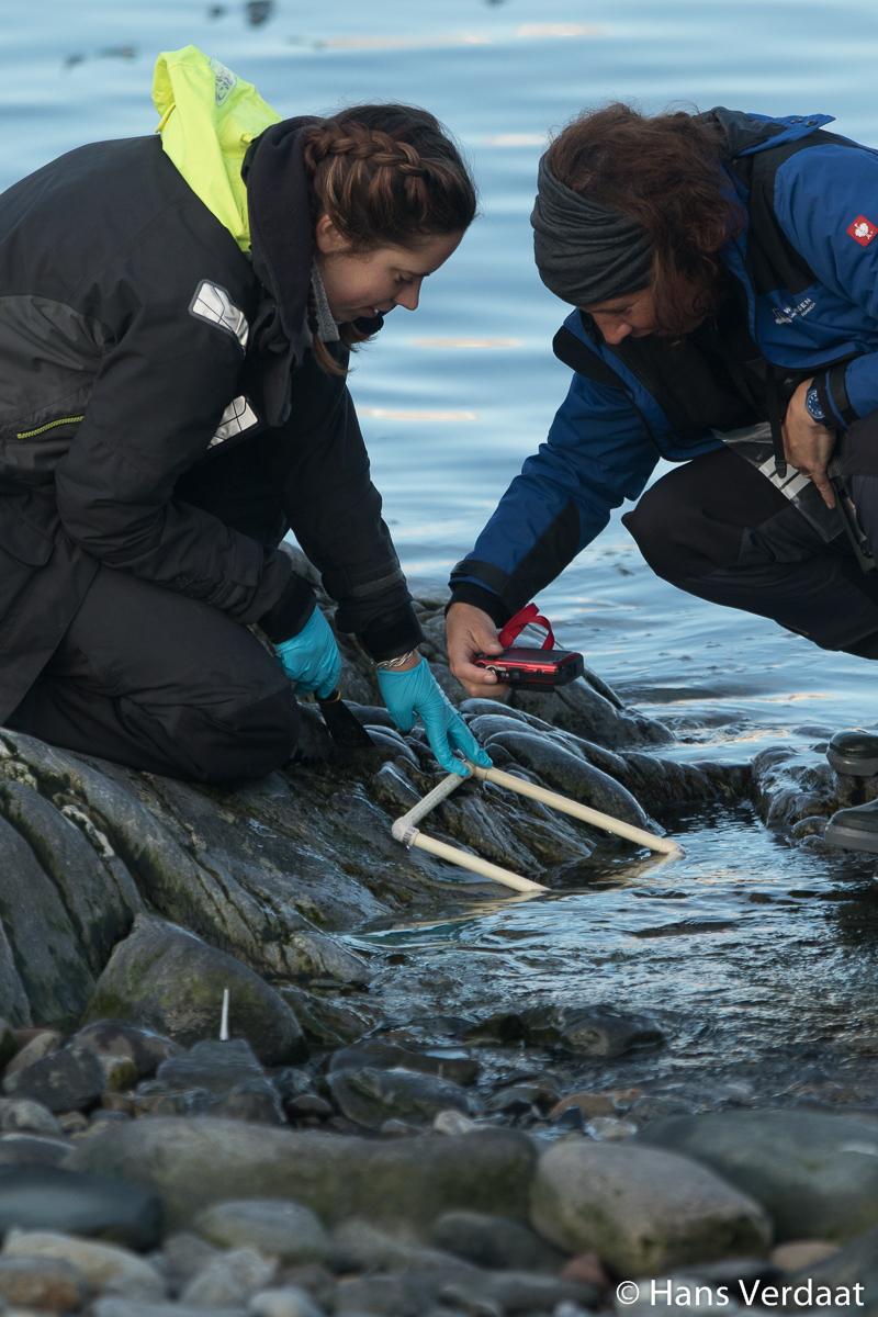 Sampling the hard substrate at Hornsund (photo by Hans Verdaat)
